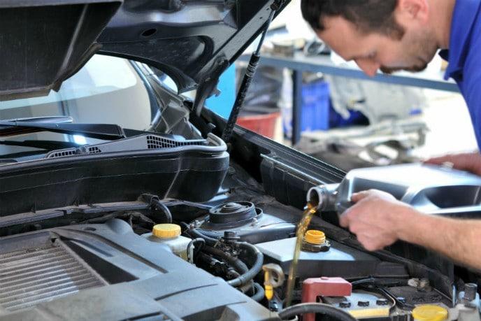 Mechanic changing oil
